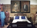 The bed of the president, at the background is his picture and wife Alicia Syquia.