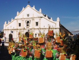 The famous Saint Paul Cathedral of Vigan City.  Binatbatan Festival dancers pose in front of the church