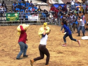 These women are stronger than men, just look at them carrying the sack of sands in the load carrying contest