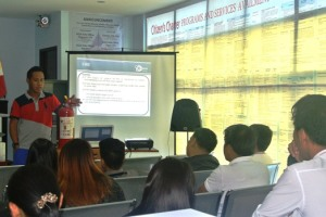 Mr. Benedick C. Sarmiento of the La Union Disaster Risk Reduction and Management Council gives a lecture on Disaster Preparedness and Basic Emergency Response to officers and staff of the OWWA RWOI on July 27, 2015 as part of its observance of the 2015 National Disaster Consciousness Month.